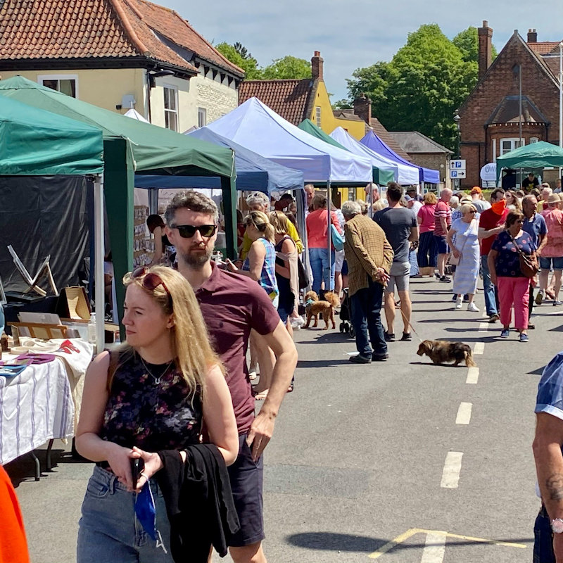 Holt Sunday Market | Head over to the pretty Georgian Town every Sunday throughout July and August with over 30 artisan stalls selling everything from pottery and tea to jewellery and cakes! | Holt, North Norfolk