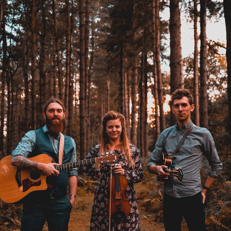 The Shackleton Trio - Sunday - Deepdale Festival | 26th to 29th September 2019 - Wonderfully talented Norfolk-based folk trio, with the unique folk voice of Georgia Shackleton complemented by the exceptional guitar of Aaren Bennett and the sublime mandolin playing of Nic Zuppardi. With their second alum under their belt, 'Fen, Farm and Deadly Water', their songwriting and playing has moved to a deeper even more assured level. Simply wonderful!