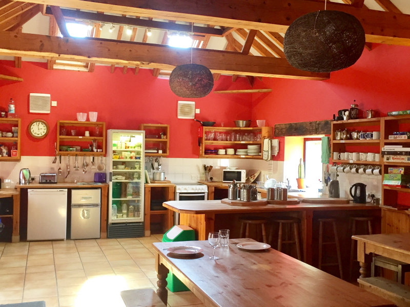 Fully equipped self-catering kitchen and dining room - Deepdale Backpackers & Camping