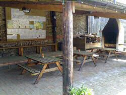 This is the BBQ area at Deepdale Old Stables with seating, BBQ and vending machine, North Norfolk Coast, England