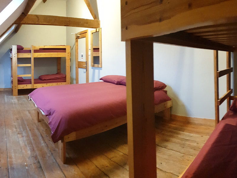 Large family room in The Granary with double bed & bunk beds, with shared shower & toilet facilities downstairs - Deepdale Camping & Rooms
